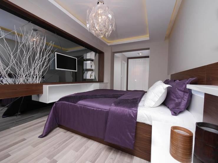 غرفة نوم تنفيذ MAG Tasarım Mimarlık İnşaat Emlak San.ve Tic.Ltd.Şti.