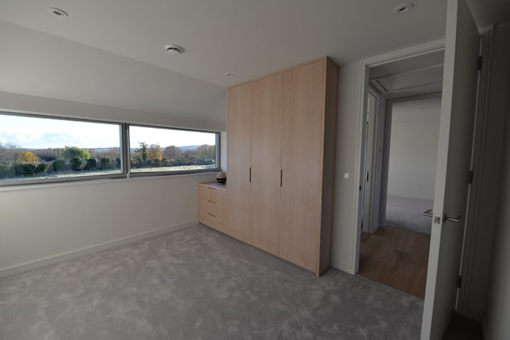 New build house:  Bedroom by BBM Sustainable Design Limited