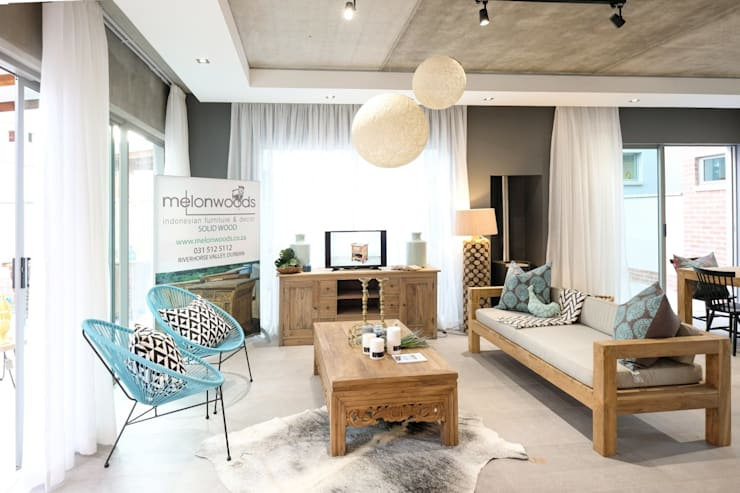 The Sheds Waterfall Estate, Midrand:  Living room by Melonwoods Indonesian Furniture