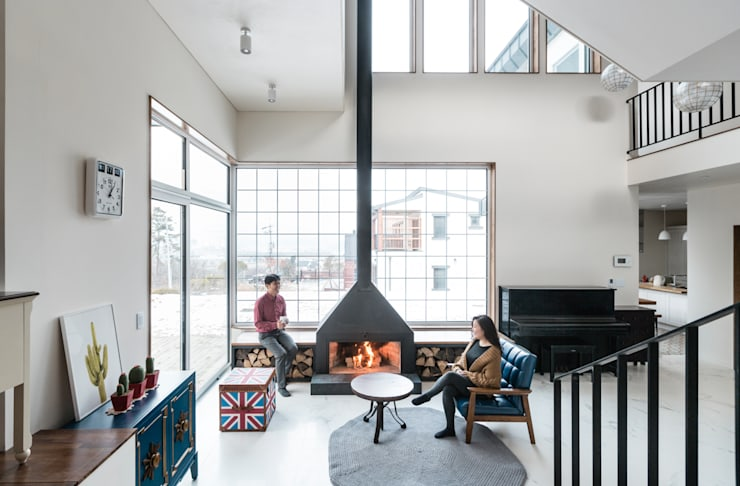 Projekty,  Salon zaprojektowane przez 라움플랜 건축사사무소