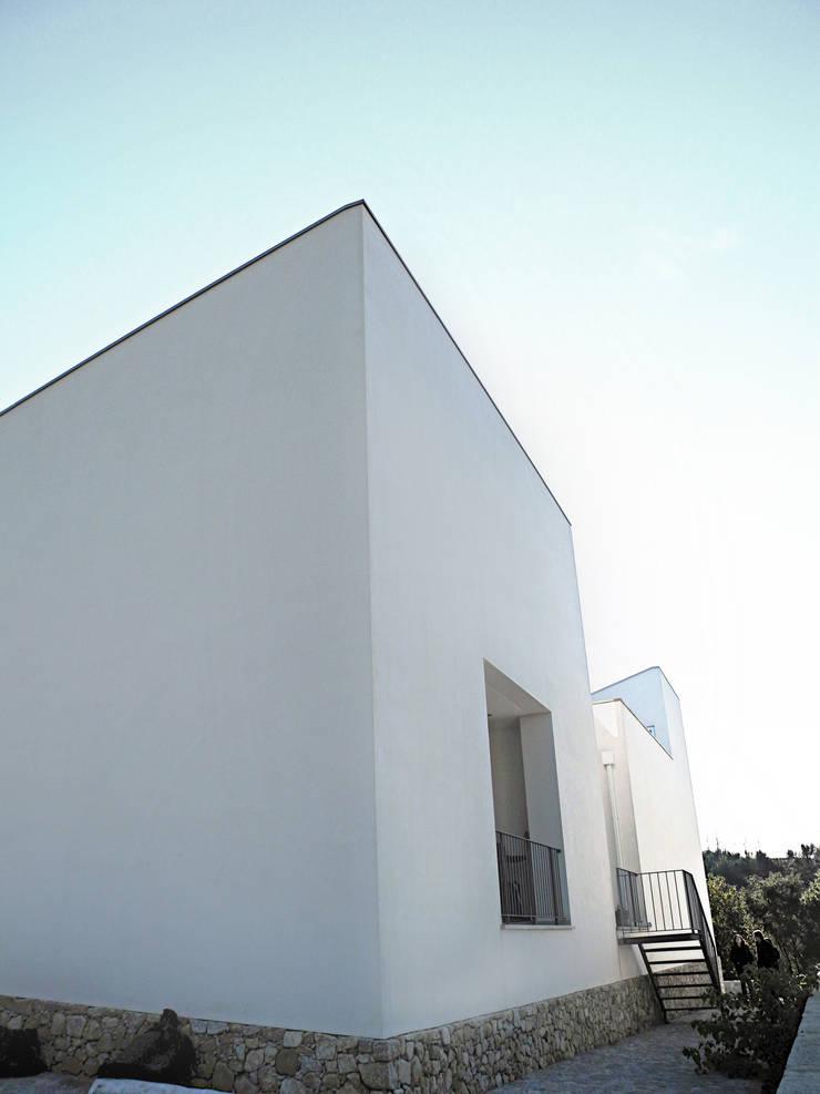 Casa A+: Casas  por Oficina de Conceitos
