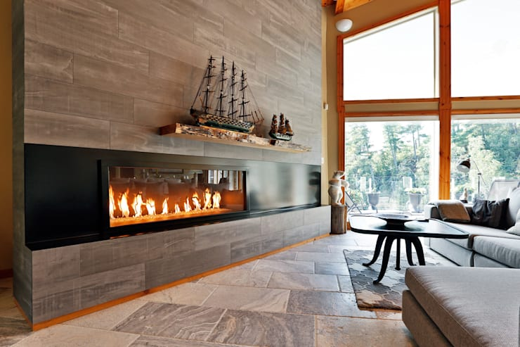 Lake of the woods cottage interiors:  Living room by Unit 7 Architecture