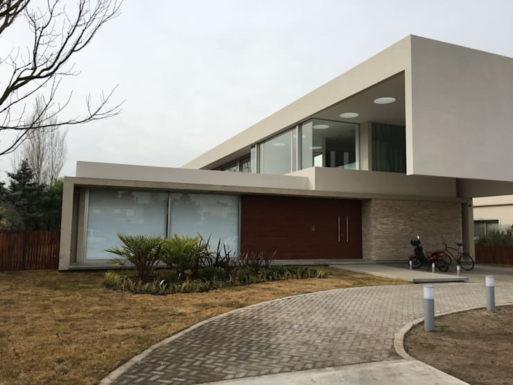 kc 123 Casas modernas de costa & valenzuela Moderno