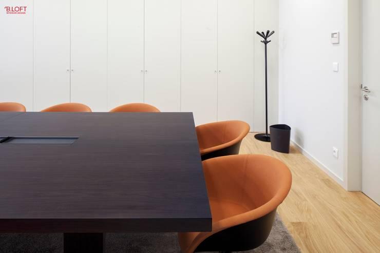 Pormenor sala executivo: Escritórios  por B.loft