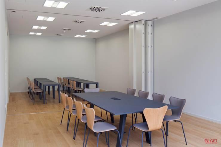 Vista geral sala de formação: Escritórios  por B.loft