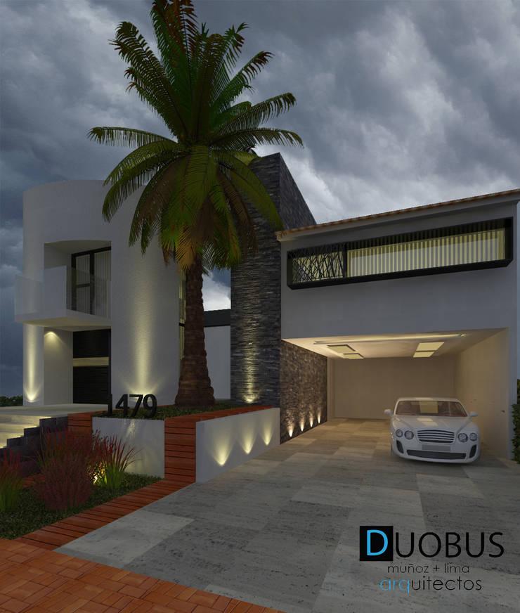 FACHADA: Casas de estilo  por DUOBUS M + L arquitectos