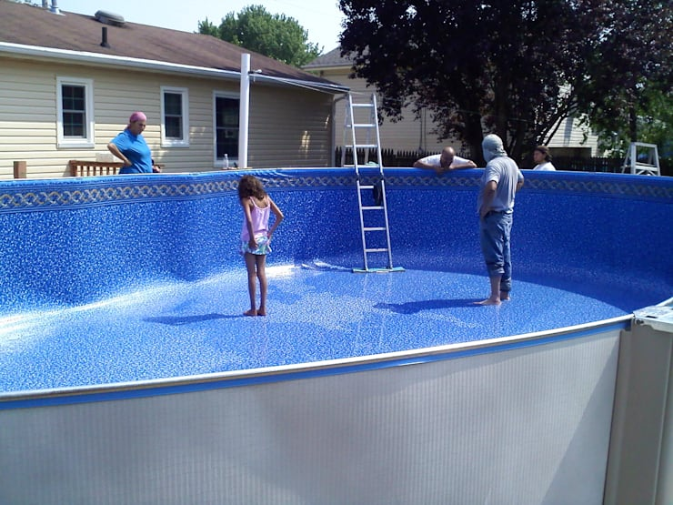 Instalación de una piscina por encima de el nivel de la tierra (Avobe ground pool):  de estilo  por Avel Benapi Services, dba, ABS Pool Patrol