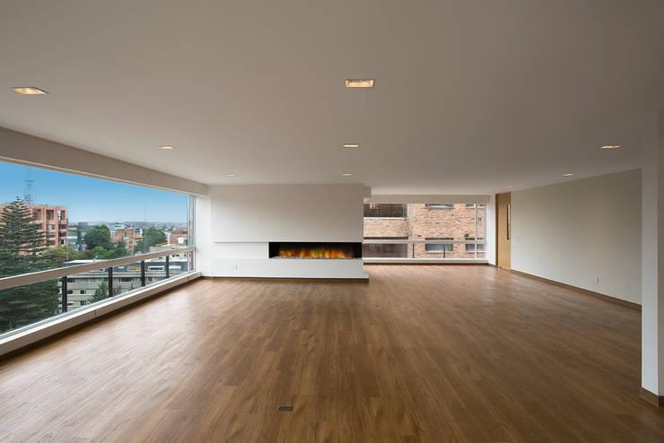 Apto Cll 77 - Cr 9: Salas de estilo  por Bloque B Arquitectos