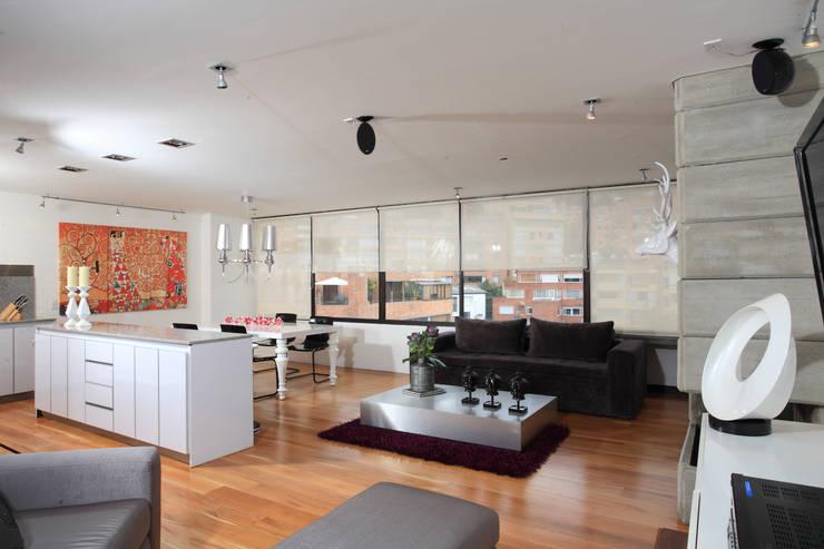 Apto Cr 3 – Cll 74 : Salas de estilo  por Bloque B Arquitectos