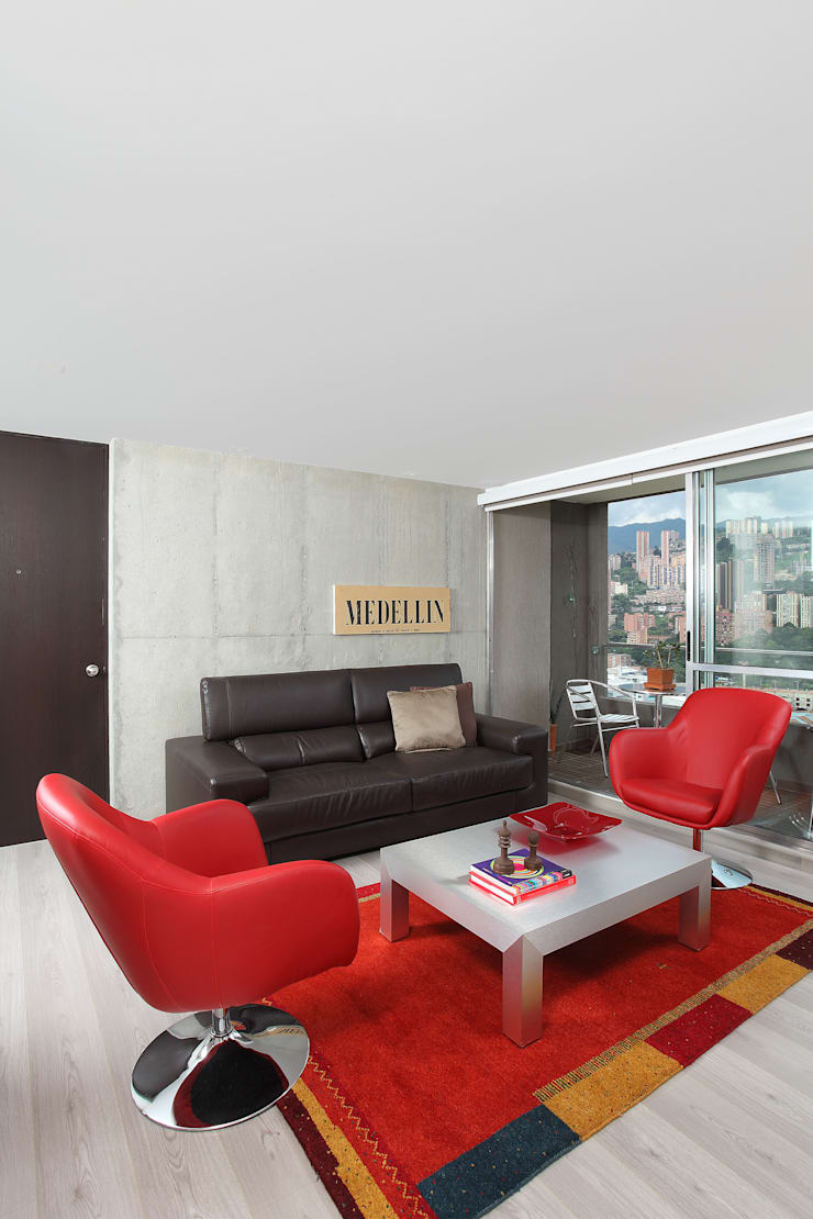 Apto Plaza del Rio: Salas de estilo  por Bloque B Arquitectos