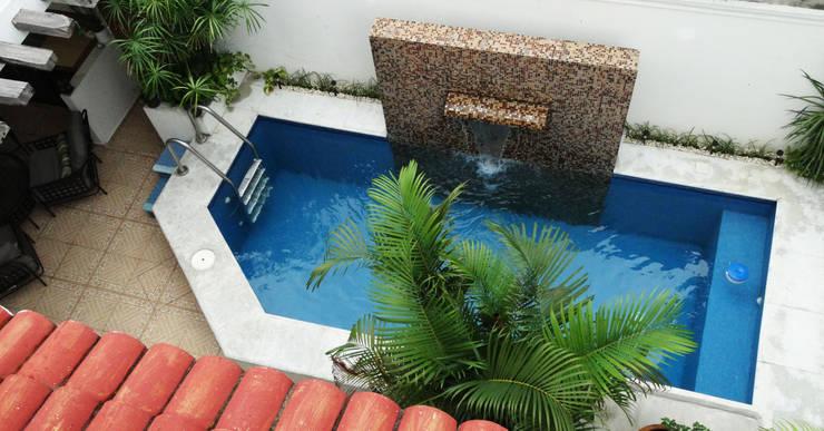 DESPUES Alberca con area de estar:  de estilo  por Arq Eduardo Galan, Arquitectura y paisajismo