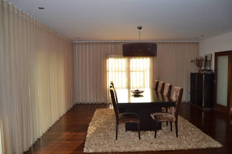 Remodelação de sala comum: Sala de jantar  por espaço MUDE