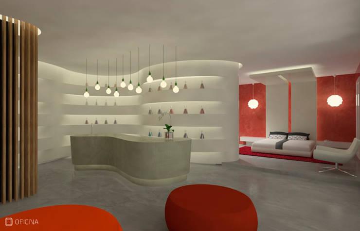 Showroom Microcrete: Lojas e espaços comerciais  por OFICINA - COLECTIVO DE IDEIAS, LDA