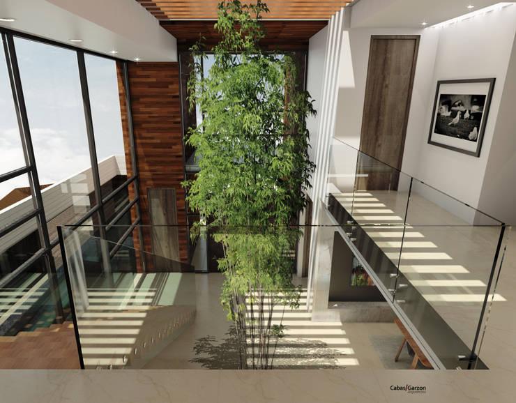CASA T C: Pasillos y vestíbulos de estilo  por Cabas/Garzon Arquitectos