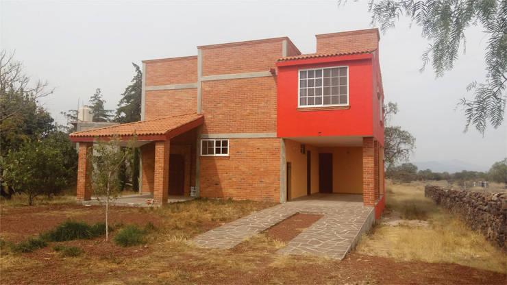 Casa de familia Escutia: Casas de estilo  por CAXÁ studio