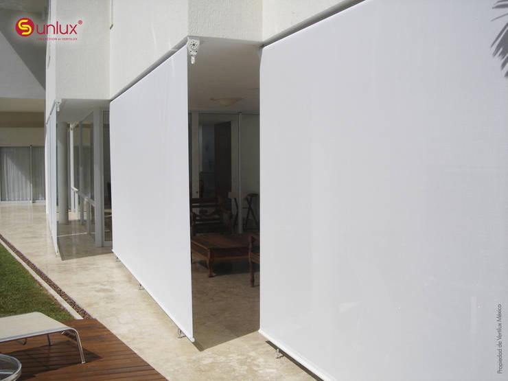 Toldo de Proyección modelo Terrace: Jardín de estilo  por Vertilux México
