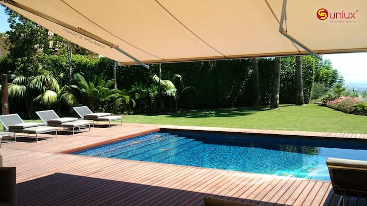 Toldo de Proyección modelo Marbella: Jardín de estilo  por Vertilux México