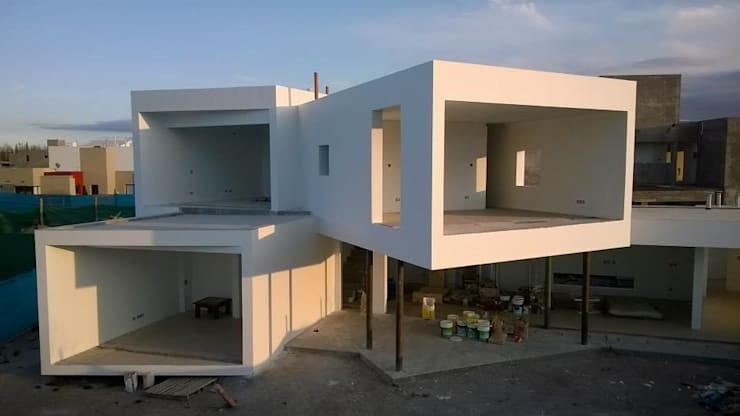 Casa Grillo: Casas de estilo  por ARQUITECTO MAURICIO PIZOLATTO,Moderno