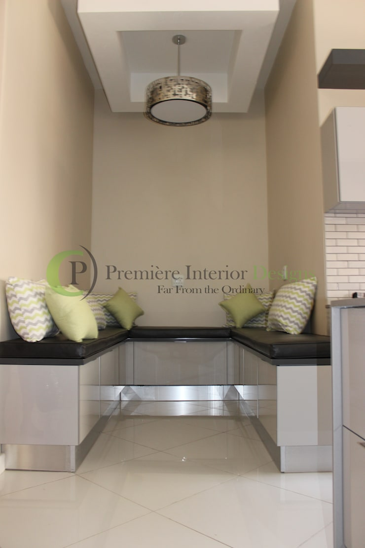 House T:   by Première Interior Designs