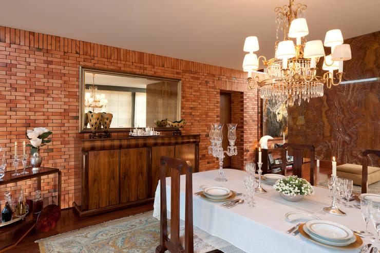 Vista sala de jantar: Salas de jantar  por B.loft