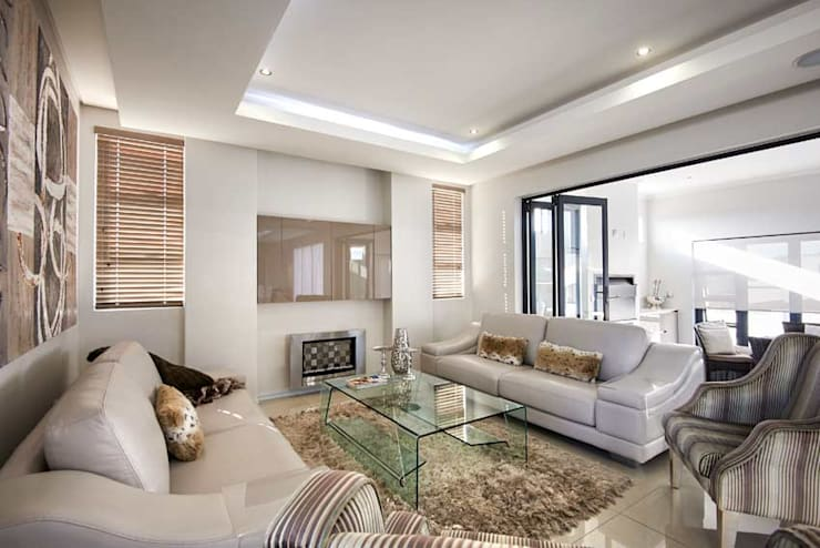 Waterfall Estate New Home:  Living room by Blaque Pearl Lifestyle