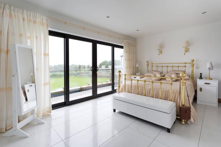 Dunadry House:  Bedroom by slemish design studio architects