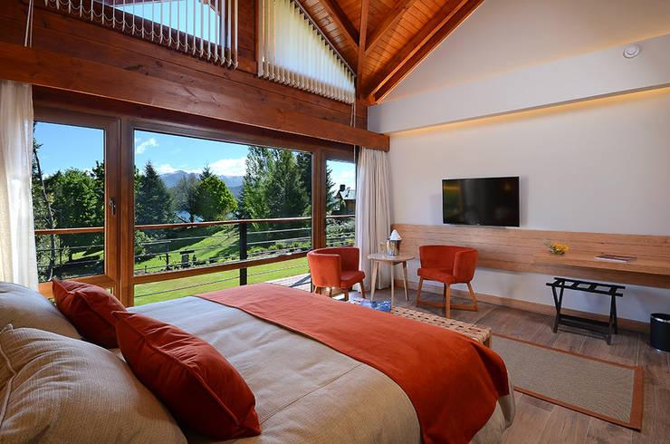 Habitacion suite : Hoteles de estilo  por INTEGRAR DISEÑO