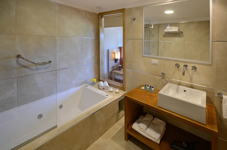 Baños: Hoteles de estilo  por INTEGRAR DISEÑO