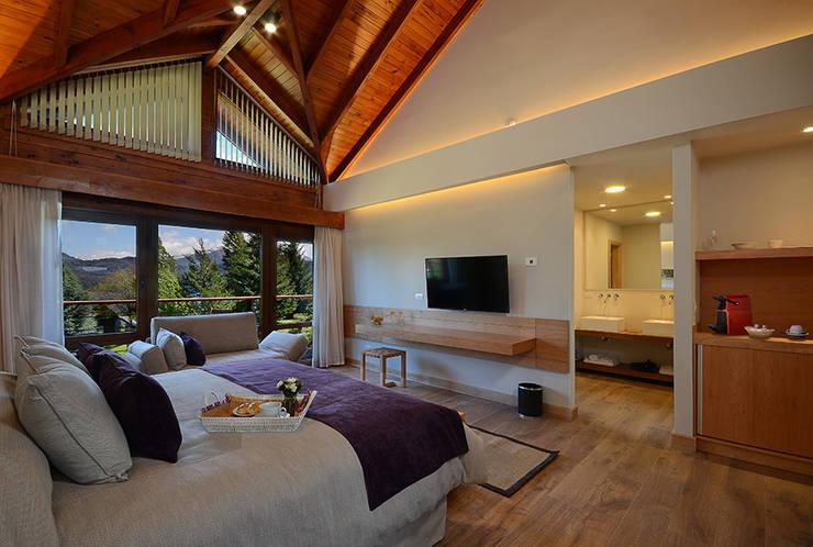 Habitacione de categoria: Hoteles de estilo  por INTEGRAR DISEÑO