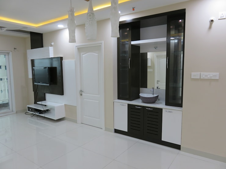 crockery cum handwash unit & LCD unit in living room: modern Living room by Bluebell Interiors