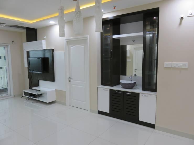 crockery cum handwash unit & LCD unit in living room:  Living room by Bluebell Interiors