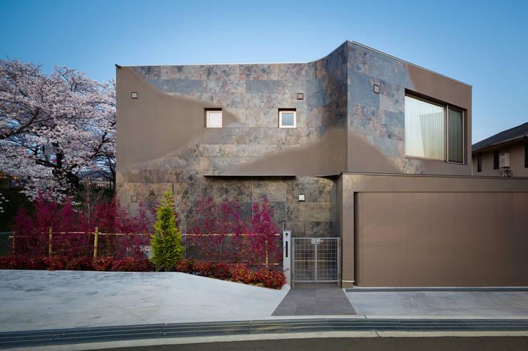 Casas de estilo  por 松島潤平建築設計事務所 / JP architects, Ecléctico Piedra