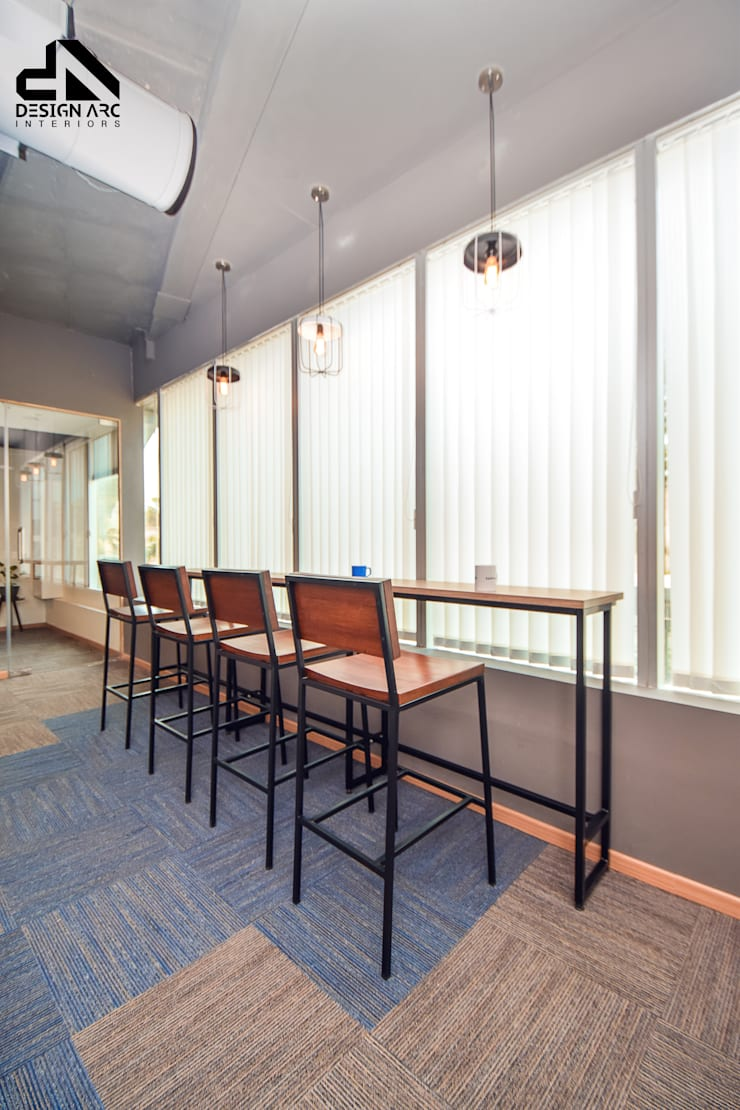 Remodelling office:   by Design Arc Interiors