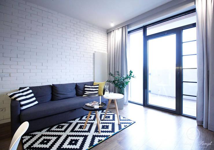 غرفة المعيشة تنفيذ Kołodziej & Szmyt Projektowanie wnętrz