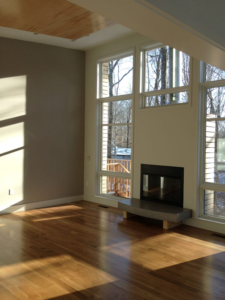 living room: modern Living room by JMKA architects