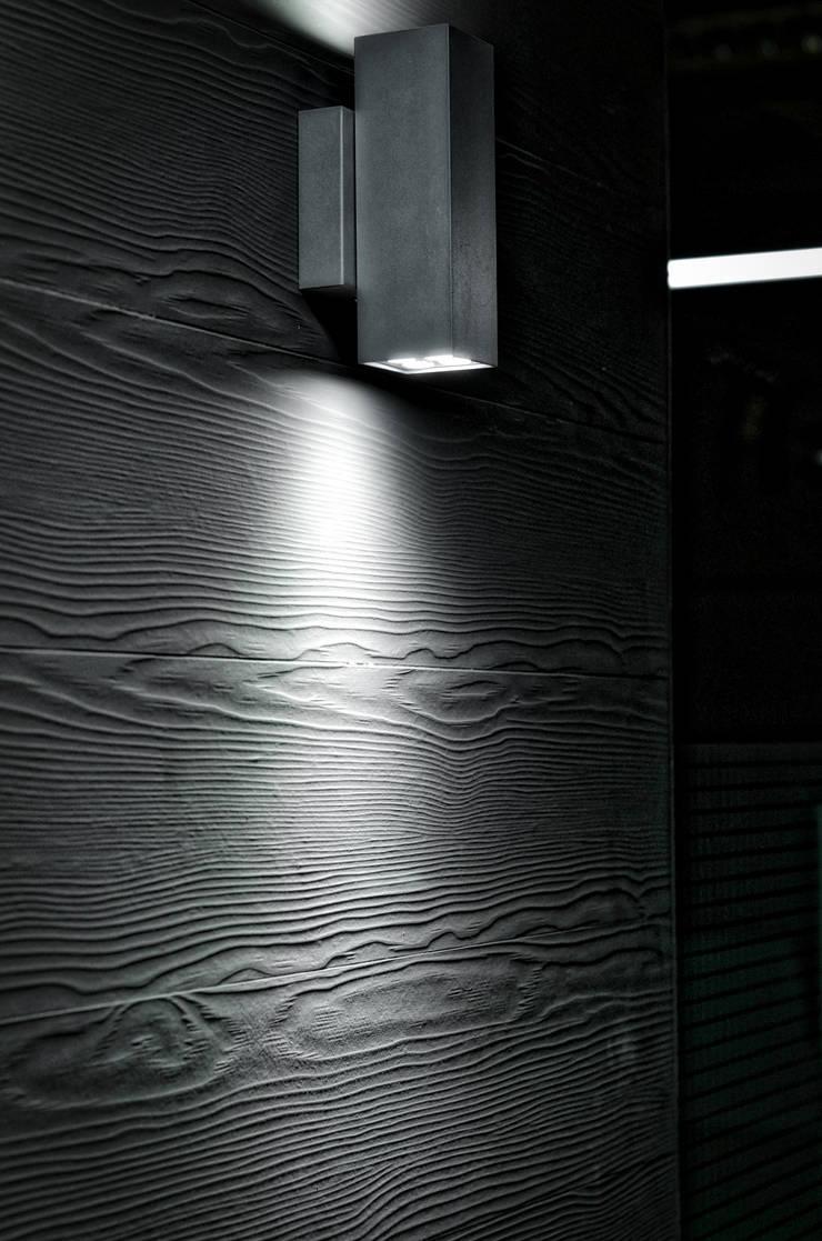 Detalle de iluminación en muros: Paredes y pisos de estilo  por ARQCUBO ARQUITECTOS