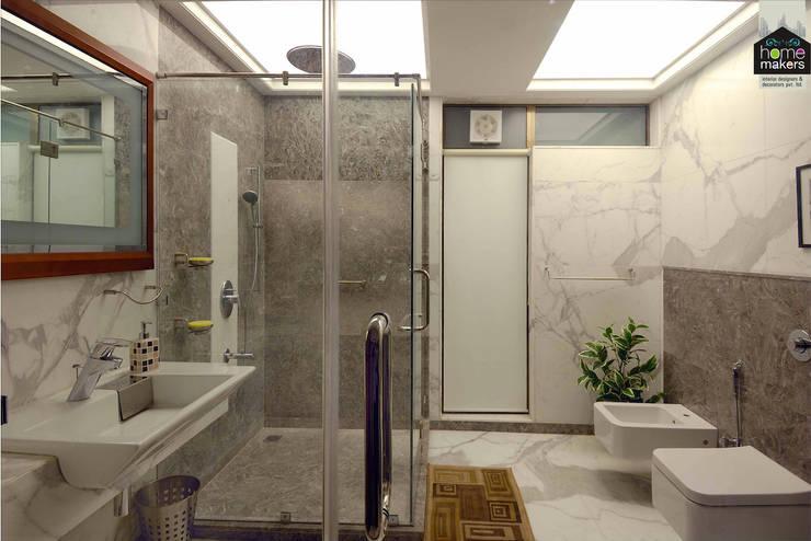 Luxurious Washroom: modern Bathroom by home makers interior designers & decorators pvt. ltd.