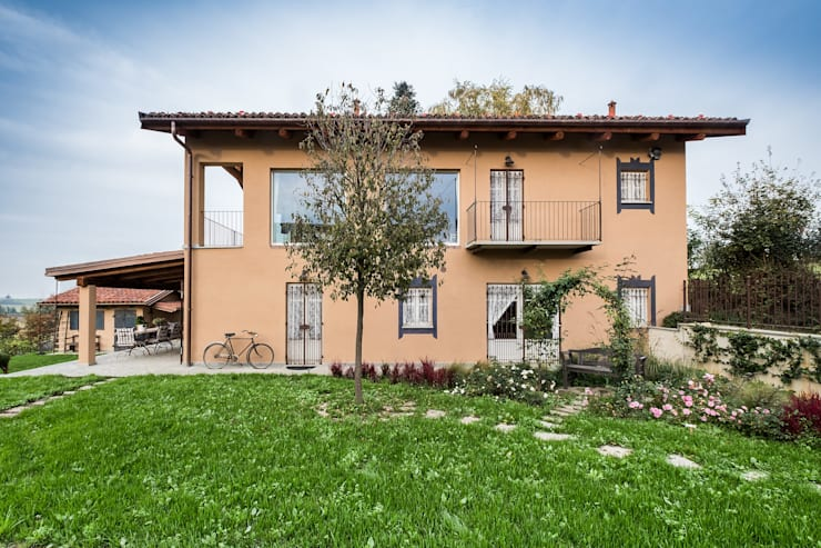 Casas de estilo  por UAU un'architettura unica