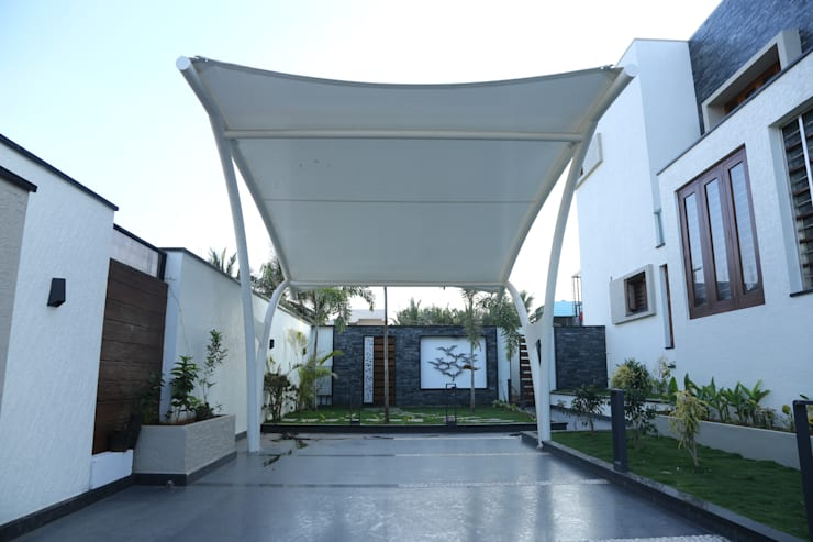 A tensile fabric car shed:  Garage/shed by Hasta architects