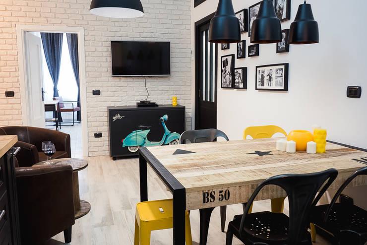 industrial Dining room by Progetti e caffè