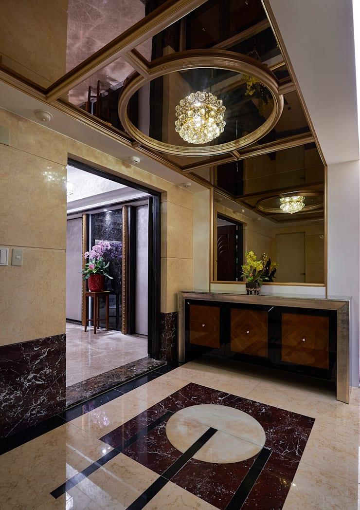 「圓」滿「金」緻的迎賓外玄關:  走廊 & 玄關 by 青瓷設計工程有限公司