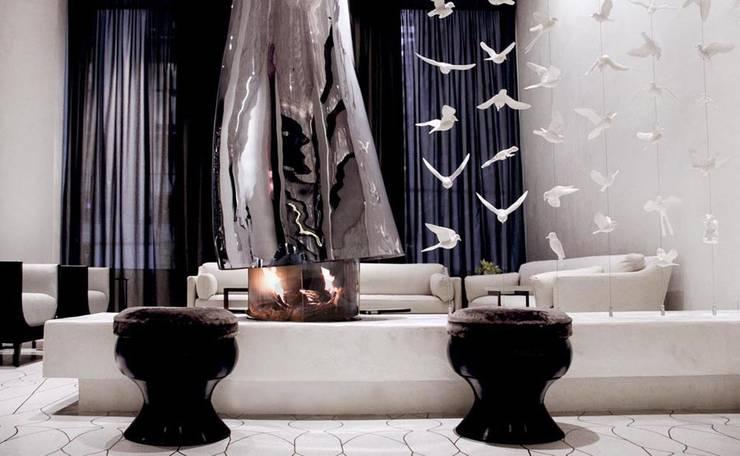 Fireplace - Lobby Marmara Park Avenue Hotel:  Hotels by Joe Ginsberg Design