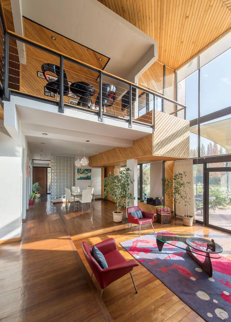 Casa Rosales Quijada: Livings de estilo moderno por GITC