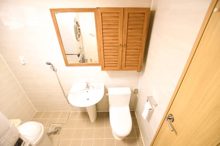 해질녘 노을이 아름다운 집: 꿈애하우징의  욕실,지중해