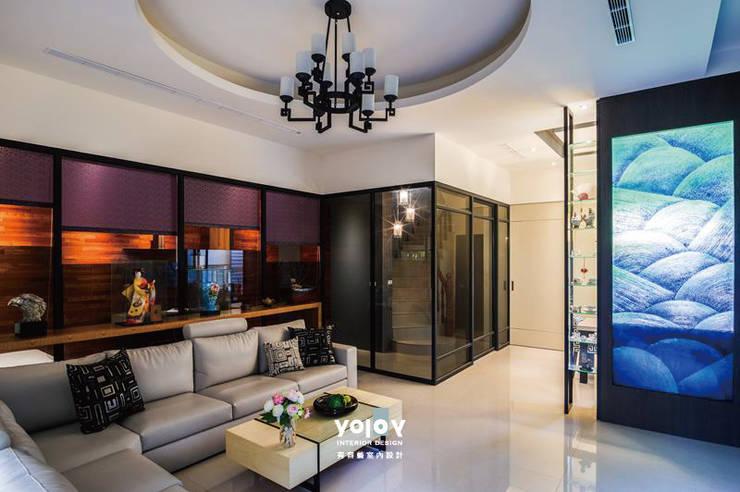 Living room by 有容藝室內裝修設計有限公司,