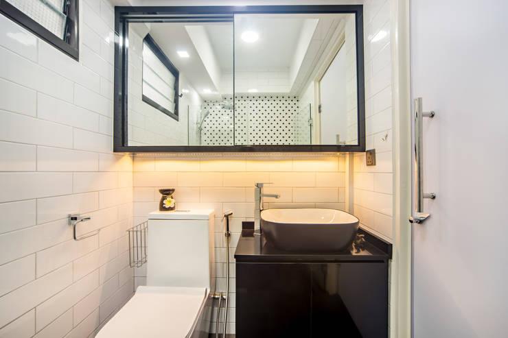 HDB Blk 293B Compassvale Crescent:  Bathroom by Renozone Interior design house,