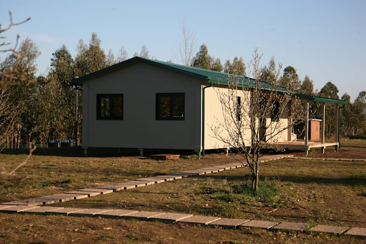 Casas de estilo rural por Cosquel, Sociedade de Construções Lda