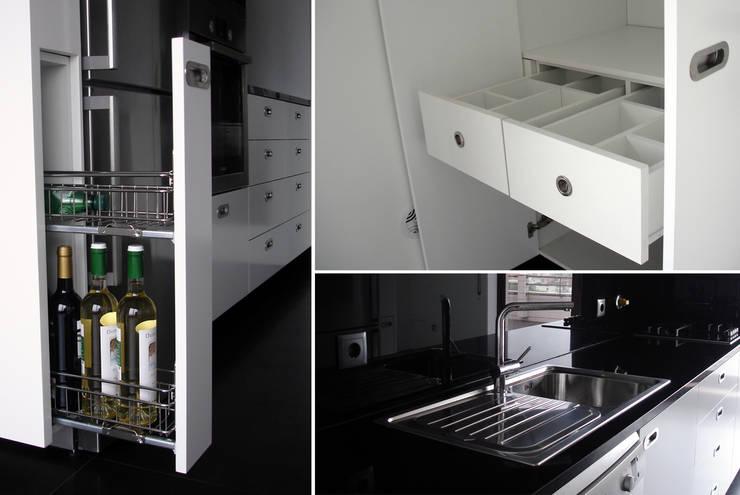 pormenores da cozinha: Cozinha  por Emprofeira - empresa de projectos da Feira, Lda.,