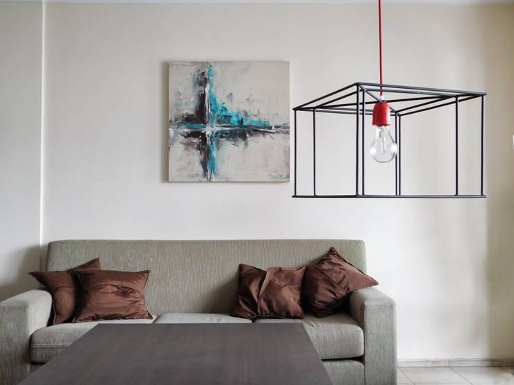 Taruca Cubo: Livings de estilo  por Artefactory,