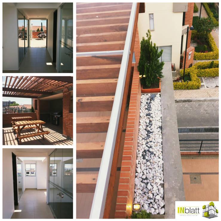 Diseño Arquitectónicoy Construcción Area Social Reserva de Mallorca Et. I Balcones y terrazas rústicos de INblatt _Arquitectura Rústico Madera maciza Multicolor